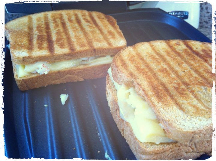 lobster grilled cheese sandwich being griddled to golden perfection.