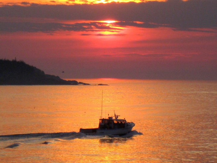 A Maine lobsterman, a symbol of untarnished, rugged independence, heading out for a day of work. Photo courtesy of Billy Kitchen.