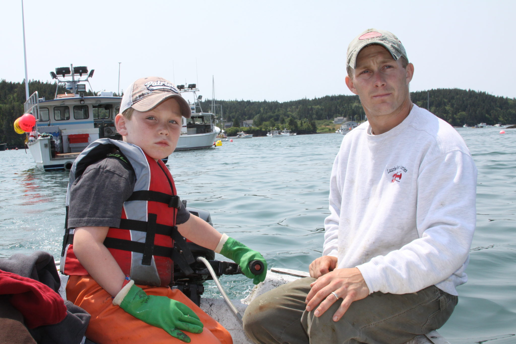 Maine lobster fishermen father son